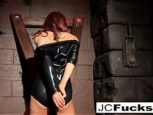 trussed hottie satiates herself while still chained up