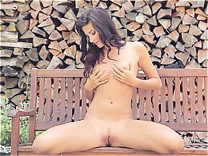 dark-haired sweetie gets nude and plays with herself