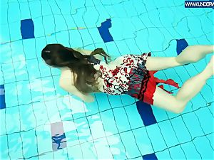 red-hot grind redhead swimming in the pool
