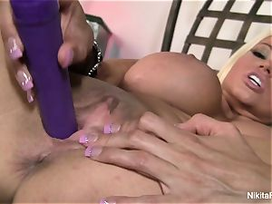 red-hot blondie Nikita plays with a purple plaything